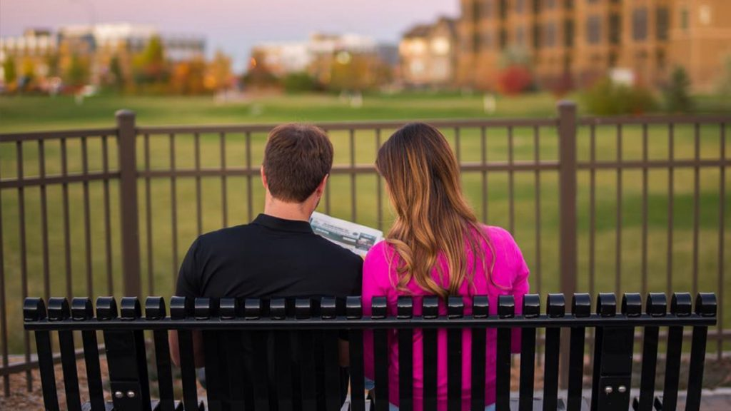 Promo Video scene of a couple on a bench in Regina Saskatchewan